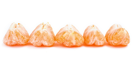 A line of satsuma, clementine or mandarin segments. Stock Photo