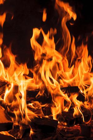 Bright burning log and fire. Closeup Stock Photo