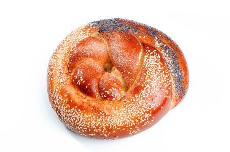 Braided bun, sprinkled with poppy and sesame seeds isolated on white background Archivio Fotografico