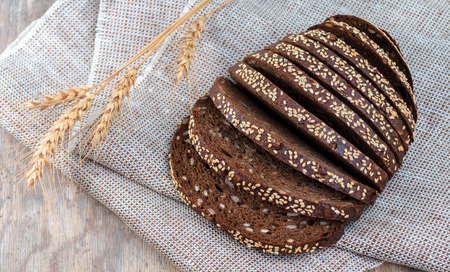 Top view on bread with ears of rye and wheat  Stock Photo