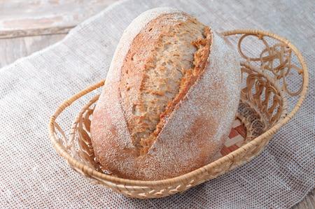 freshly baked loaf of bread on vintage background Zdjęcie Seryjne
