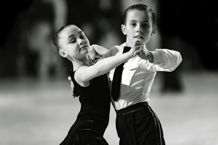 Bila Tserkva, Ukraine. February 22, 2013 International open dance sport competition Stars of Ukraine 2013. Children dancing couple. Black and white photography