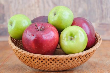 wicker basket full of fresh apples