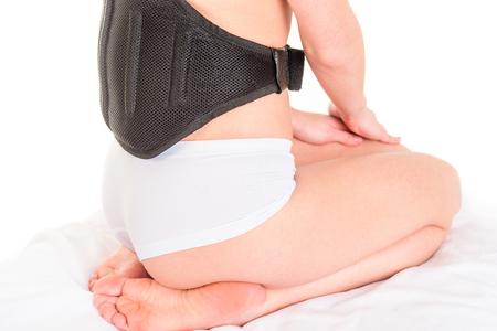 Body of woman doing massage with Electric vibrating massage belt