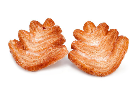sweet puff pastry in the form of a Christmas tree. Bakery products isolated on white