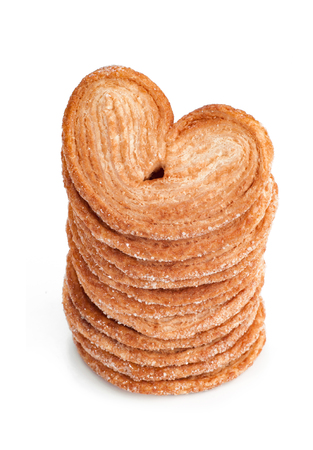 tasty heart shape Cookies in stack isolated