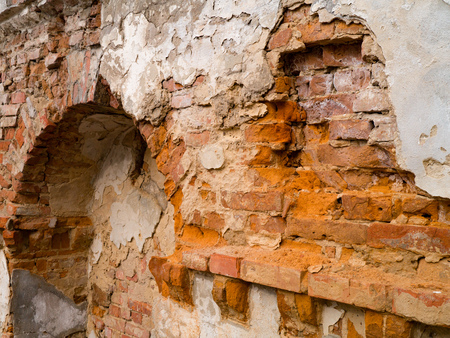Ancient brick wall collapsing from antiquity