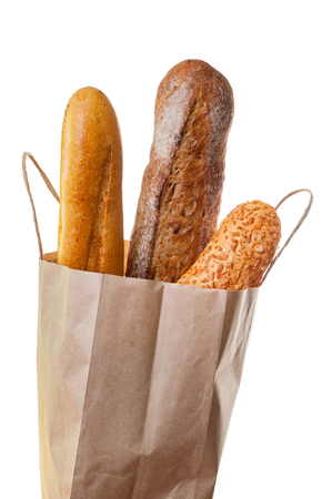 hot buns in paper bag. Fresh and tasty, perfect for your lunch or breakfast. Closeup view isolated on white