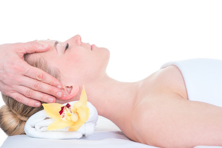 health, beauty, resort and relaxation concept. Beautiful young woman in spa salon getting face treatment