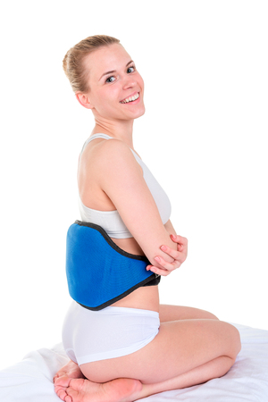 woman doing massage with Body Vibrating Slimming Belt. Isolated on white background