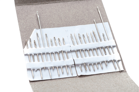 Photo of hand-sewing needles types. Handmade tools closeup view