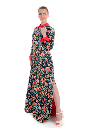 Beautiful Busyness Woman Fashion Model in summer printed long dress with slit