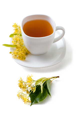 Green herbal tea  with linden flowers isolated on white background