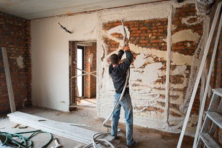 Plastering Walls with a plasterer pump Machine