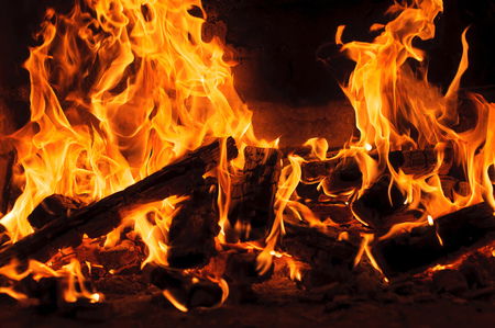 Closeup image of fire and wood burning in a fireplace Stock fotó