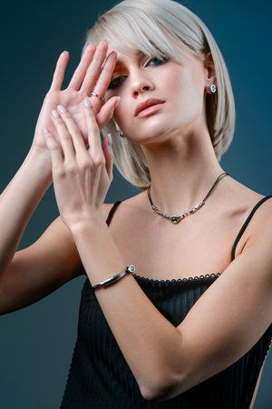 Fashion model woman wearing necklace with blue stone. Stock Photo