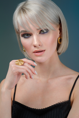 beautiful young girl with fashionable jewelry earrings and ring Stock Photo