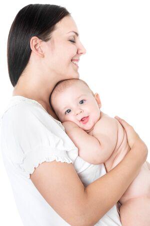 Mujer bonita sosteniendo a un bebé recién nacido en sus brazos Foto de archivo