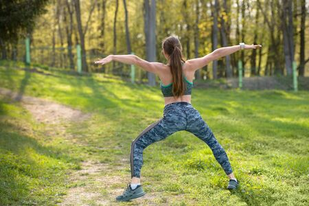 MMA fighter in combat stance. Exercises in nature Фото со стока