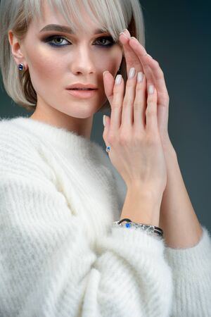 portrait of beautiful young girl with luxury silver jewelry