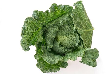 Savoy cabbage isolated on a white background. Photo of a raw vegetable. Vegetarian and healthy food Фото со стока
