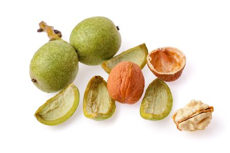 Green walnut. Peeled walnut and its kernels. Isolated on a white background.