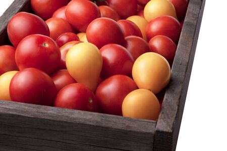 Close-up of fresh, ripe tomatoes in wood box