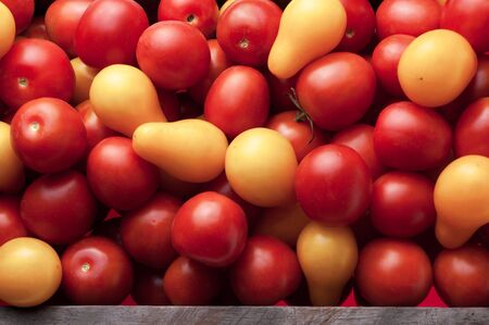top view of fresh, ripe tomatoes in wood box. Close-up