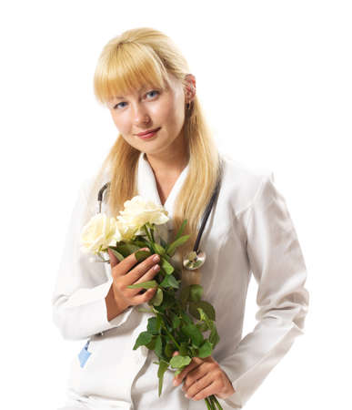 Doctor woman holding a bouquet of white roses and smiling