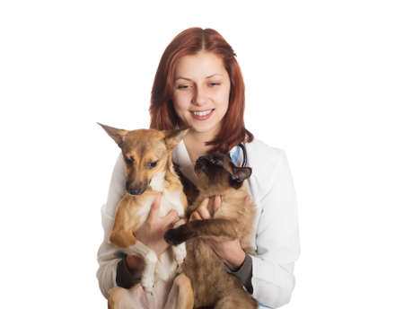 veterinarian with pets in the hands on a white background isolated photo