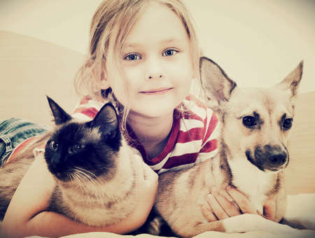 child hugging a cat and dog Reklamní fotografie - 27723986