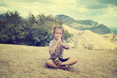meditates: little girl meditates