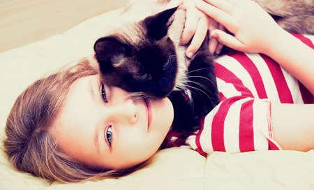 little girl hugging a cat Stock Photo - 27724214