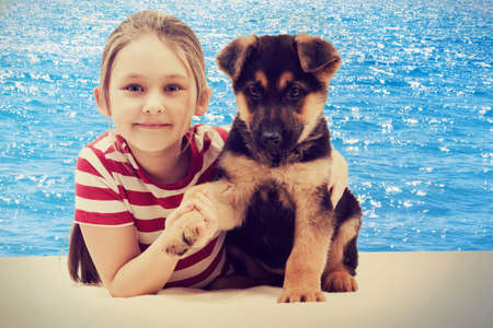 child and puppy  photo