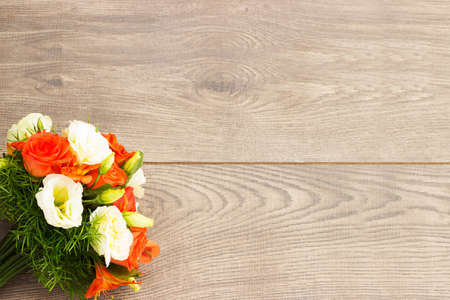 flower bouquet: bouquet of flowers on a wooden background