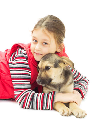 mutts: Portrait of a Girl and puppy mutts on a white background isolated