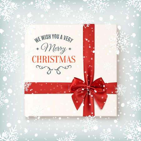 sorpresa: Plantilla de tarjeta de felicitación de la Feliz Navidad. Realista icono de regalo, vista desde arriba en el fondo de invierno con la nieve y los copos de nieve. Ilustración del vector.