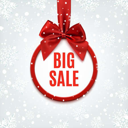 Big sale, round banner with red ribbon and bow, on winter background with snow and snowflakes.