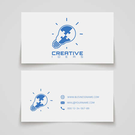 puzzle business: Business card template. Light bulb with jigsaw puzzle pieces inside. Conceptual logo. Vector illustration.