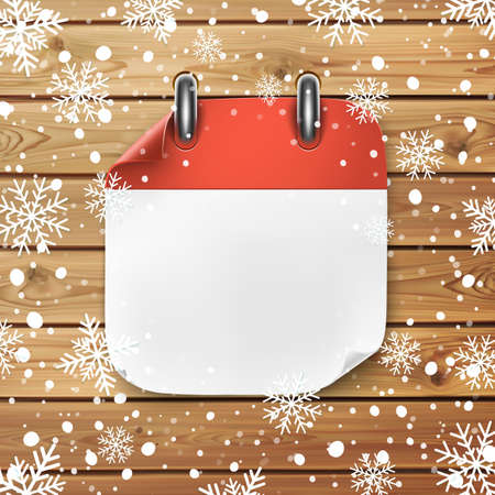 Blank calendar icon template on wooden planks background with snow and snowflakes.
