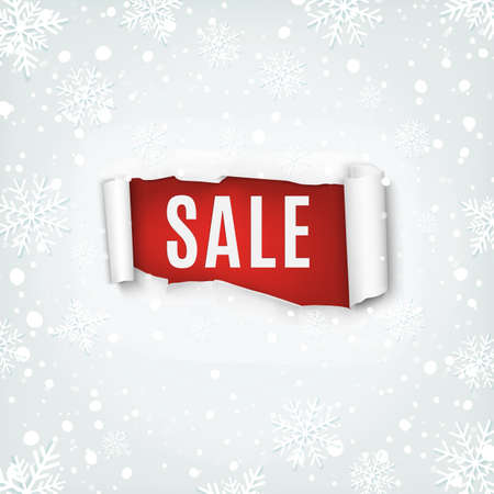Sale. Torn papper banner on winter background with snow and snowflakes.