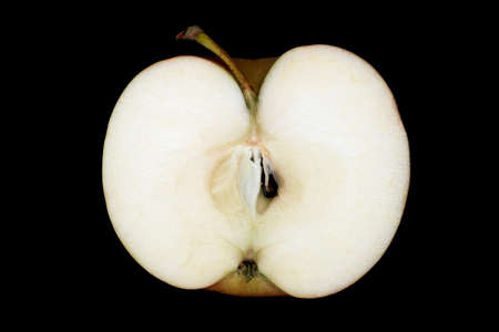 seasonal apple in the section with peduncle on a black background
