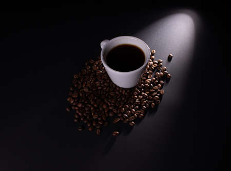 Diagonally directed light on a mug of coffee beans in a drink