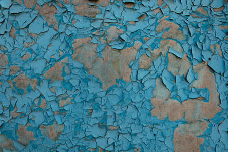 surface with collapsing paint under the influence of moisture and sunlight