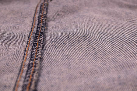 light denim on the seamy side with threads from the stitching