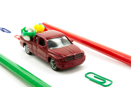 laden: Toy car laden Stationery items traveling on the road Stock Photo