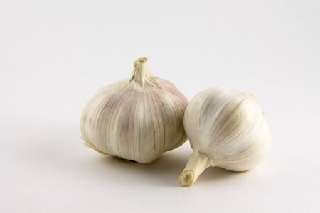 flavorings: Garlic is isolated on a white background Stock Photo