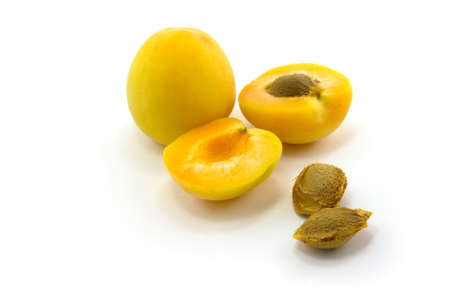 apricot kernels: Apricot and its parts are isolated on a white background Stock Photo