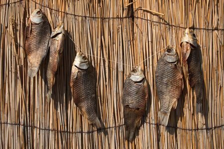 weighs: dry fish weighs a number of provisions of the straw rows Stock Photo