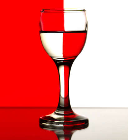 sulphide: Glass is on a red and white background Stock Photo